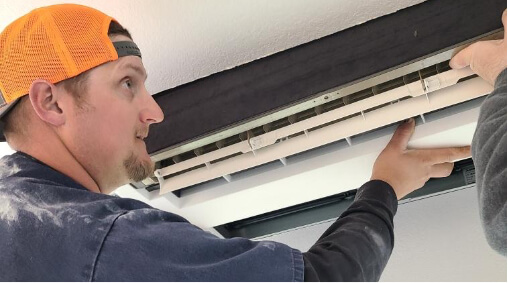 Technician working on an AC unit