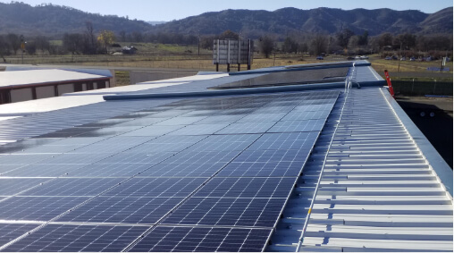 A large solar array on the rooftop of a commercial facility