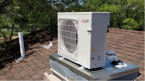 An outdoor heat exchange unit on a rooftop