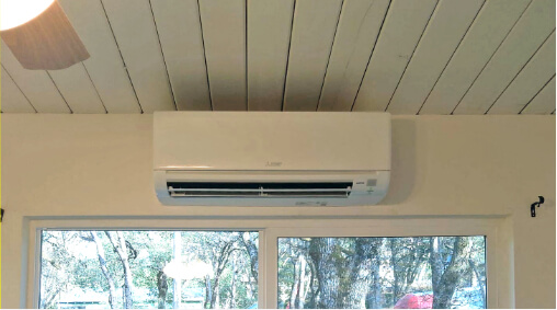 A ductless Mini-Split mounted above a window.