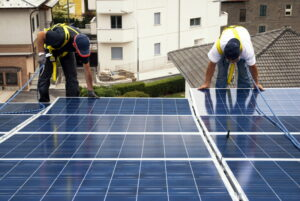 two-technicians-installing-soloar-panels-on-roof