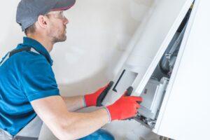 technician-servicing-furnace